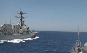 美宙斯盾舰危险接近俄军舰 相距70米斜插横越