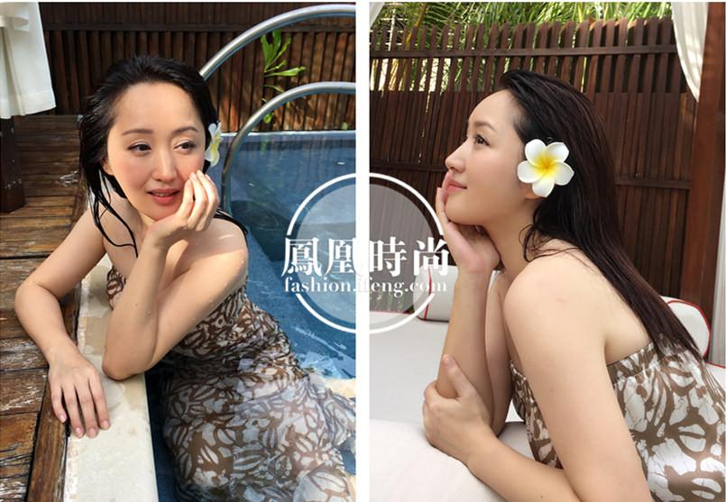 图为杨钰莹晒生活照,低头轻嗅鲜花