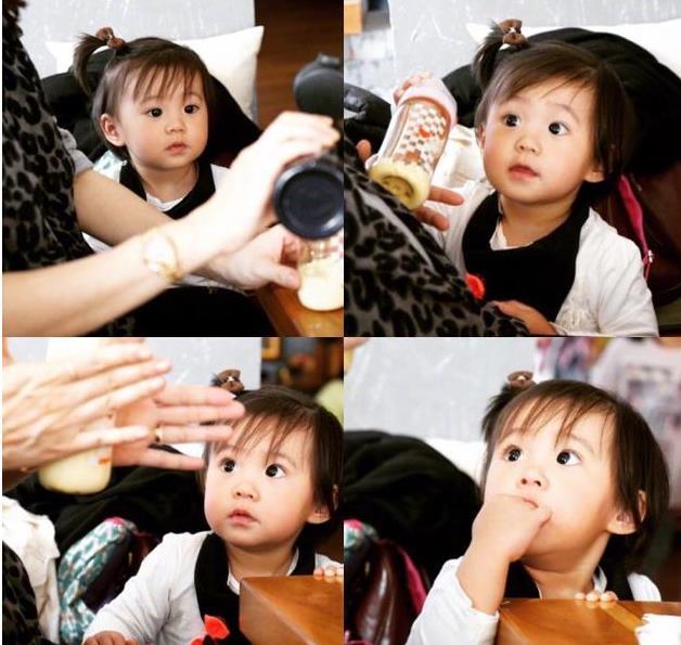 修杰楷为女儿冲牛奶 咘咘大眼呆萌超想喝