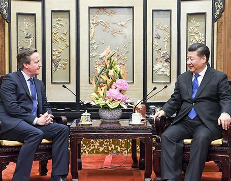 习近平会见英国前首相卡梅伦