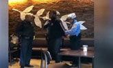 2名无故被捕黑人男子与星巴克和解 可免费上大学