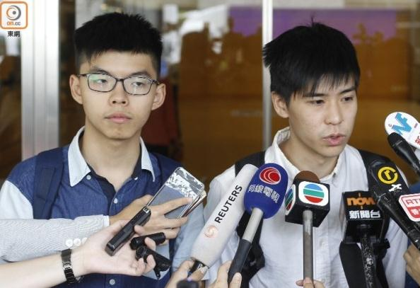 """16名""""占中""""分子今判刑 黄之锋被判3个月仍露微笑"""
