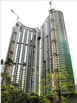 广州最出名的烂尾楼,现中石化大厦,曾经两度烂尾,直到2009年才完工