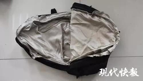 △缝有隔磁布的提包